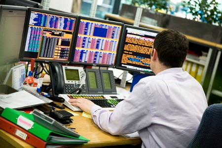bigstock-man-in-trading-office-4018267-450x300
